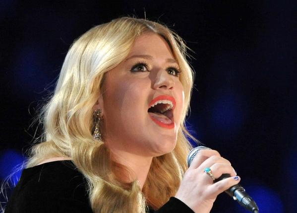 Kelly Clarkson performs on stage at the 55th annual Grammy Awards in Los Angeles.