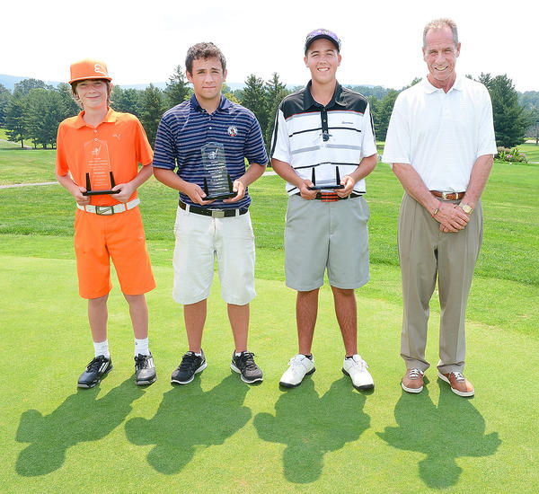 The Tri-State Junior Golf Association Tournament of Champions winners - from left, Noah Reeder (12-13 age division), Jake Darr (14-15) and Ryan Crabtree (16-18) - stand with Junior Golf Director Bill Hoffman on Monday at Beaver Creek Country Club.