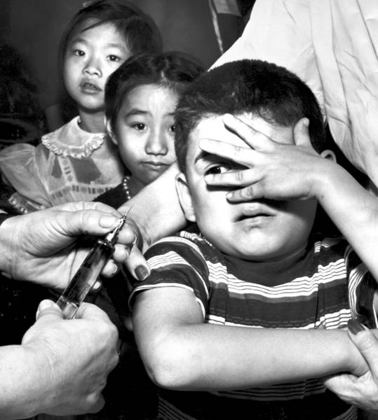 Children in 1957 receive polio vaccine shots.