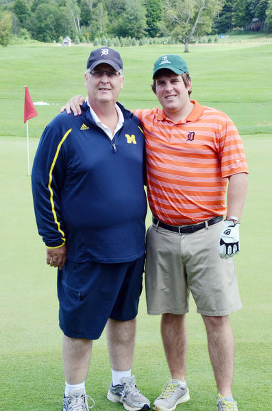 Sean McMahon (right) of Waterford stands next to his father, John McMahon, prior to his round of golf Saturday at Boyne Highlands Ross course. McMahon, who recently returned home following four years of service in the Marine Corp. where he eventual became a captain, was treated to the round by Boynes First Tee and AJGA volunteer Frank Jones and Boynes director of golf Mike Chumbler.