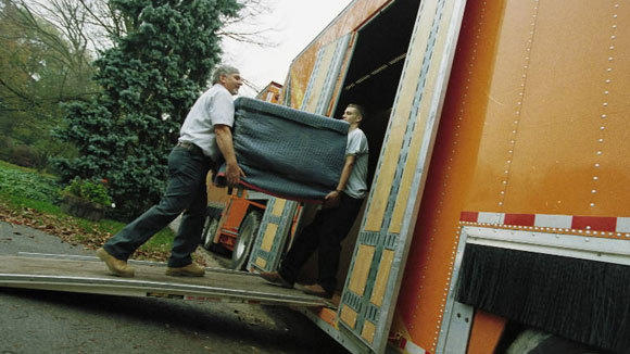 Allied van movers load a truck in a 1998 file photo.