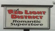 'Red Light District' sign for adult store in Salisbury is illegal, mayor says