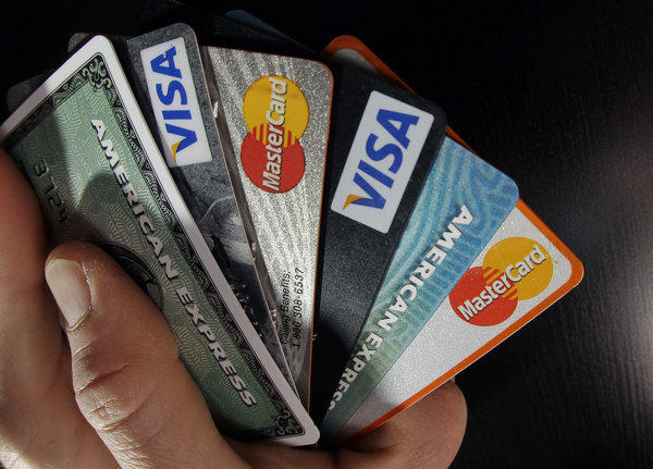 The rate of credit card payments at least 90 days overdue fell in the second quarter to the lowest level since 1994, according to credit reporting agency TransUnion.