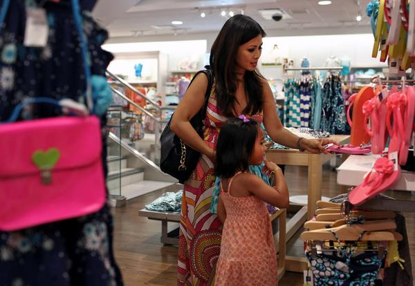 July retail sales rose a smidgen, growing 0.2% amid back-to-school shopping even as auto dealers and home goods merchants lagged.