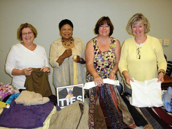From left to right, Assistant Cook County State's Attorney Mary Lou Norwell, Cook County Judge Donna Cooper, Cheryl Kokaska and Kathy Passafiume participated at the the Orland Township Clothing Drive on Saturday.