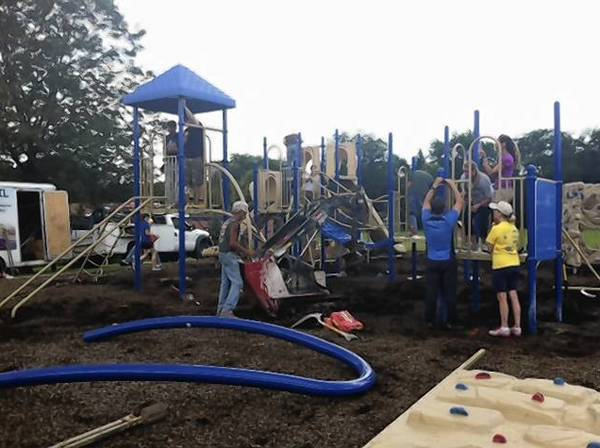 Volunteers install new playground equipment Saturday at Copeland Manor School in Libertyville.