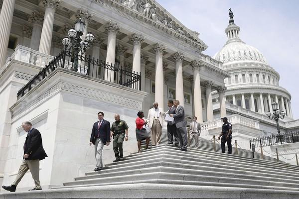 Members of the House of Representatives leave the U.S. Capitol Aug. 2 as Congress begins its summer recess without a deal on a federal budget, paving the way for a possible government shutdown in September.