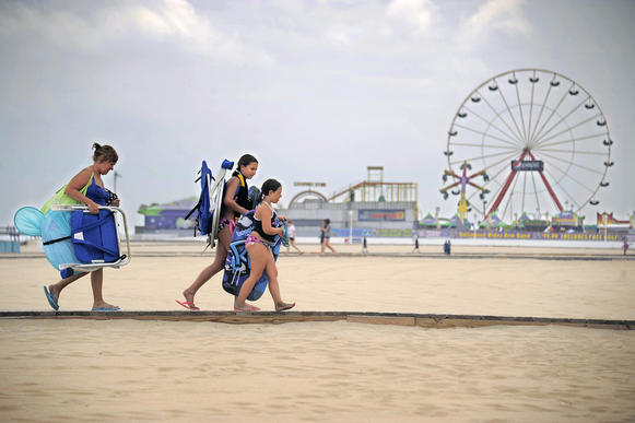 Marykate Rim of Monroeville, PA walks behind granddaughters Mackenzie Pfeifer, 7 and Leah Rim, 11 back to the Boardwalk in lower Ocean City