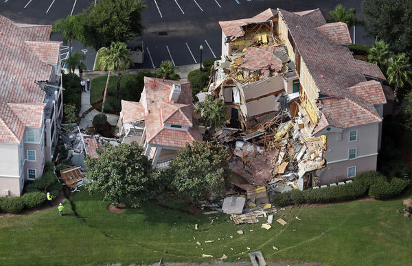 Aerial view Monday, August 12, 2013 after a sinkhole swallowed two buildings at Summer Bay Resort late Sunday night.