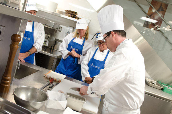 Chef Lachlan Sands, president of Le Cordon Bleu's cooking school in Las Vegas, demonstrates kitchen techniques to students.
