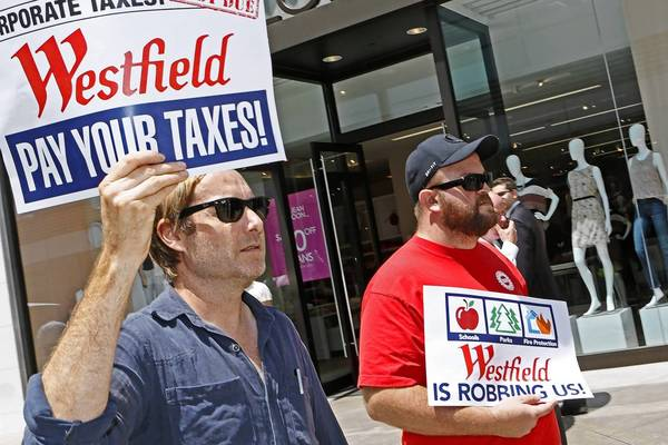 Nate Greely, left, and James Banks, members of a coalition of community, education and labor unions called Refund L.A., protest at Westfield Century City Mall in Los Angeles last month to demand that Westfield pay more in property taxes.
