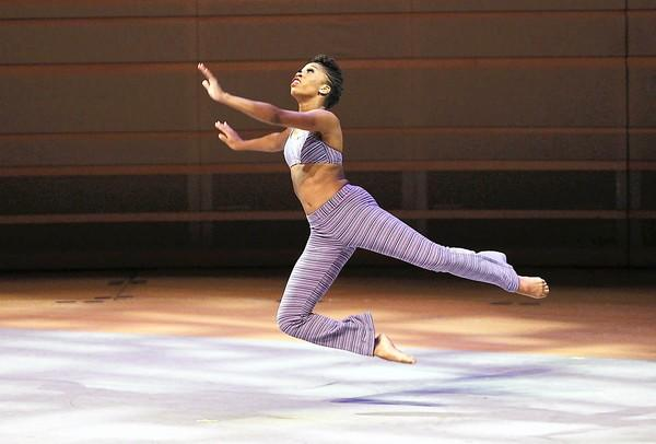 "Daphne Lee takes flights as she performs Robert Battle's ""Takademe"" during a preview performance of the Alvin Ailey American Dance Theater at the Segerstrom Center for the Arts in Costa Mesa on Monday."