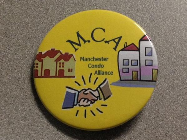 These buttons were handed out at the board of directors meeting Tuesday night. The Condo Alliance won a victory with the board's decision to extend trash and recyclable collection rebates to all condo owners.