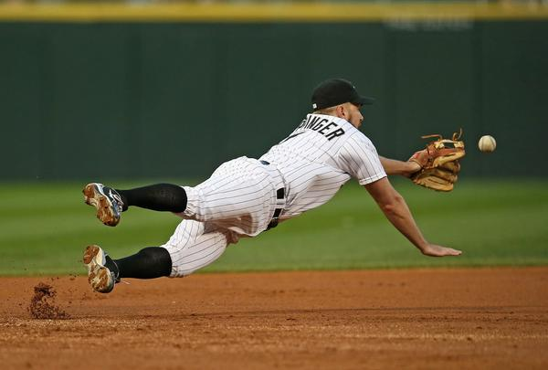 Jeff Keppinger dives in vain for a ball hit by Brayan Pena of the Tigers.