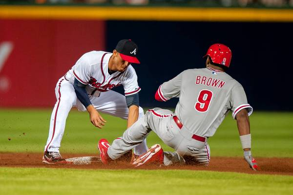 Atlanta Braves shortstop Andrelton Simmons (19) tags out the Phillies' Domonic Brown in the sixth inning at Turner Field.
