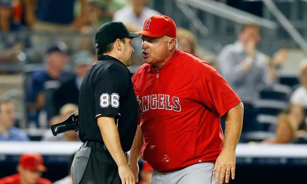 Angels Manager Mike Scioscia argues a call with home plate umpire David Rackley during the sixth inning of the Angels' 14-7 loss to the New York Yankees on Tuesday.