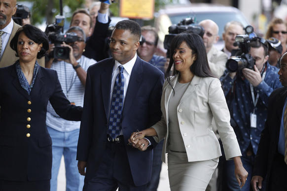 Jesse Jackson Jr. and his wife Sandi Jackson arrive for their sentencing hearing today at the E. Barrett Prettyman Federal Courthouse in Washington.