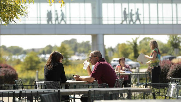 Employees use the patio at the Discover Financial Services headquarters in Riverwoods in a 2011 file photo.