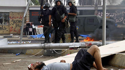 Egyptian security forces clear pro-Morsi protests - Injured man