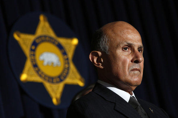 Sheriff Lee Baca will be challenged in next year's election by retired Los Angeles County sheriff's commander Bob Olmsted.