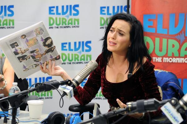 "Katy Perry, shown during a visit to a New York radio station, has generated fan speculation over similarities between her new single ""Roar"" and Sara Bareilles' song ""Brave."""