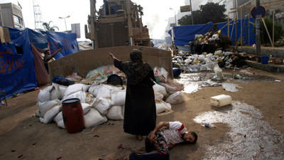Egyptian security forces clear pro-Morsi protests - Egyptian woman
