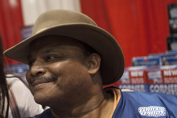 "Chicago Bears legend William ""the Refrigerator"" Perry posses with Maggie Jarrett for a picture during an appearance at an ACE Hardware convention at McCormick Place in Chicago, Saturday, April 2, 2011."