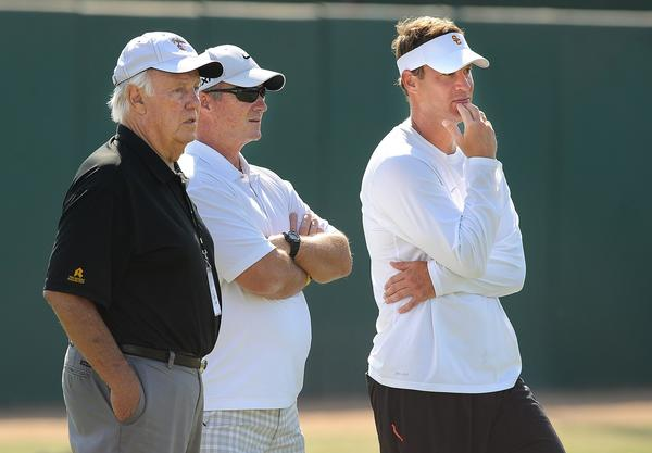Former college coaches John Robinson, left, and Jeff Tedford, center, watch practice with USC head coach Lane Kiffin at USC.