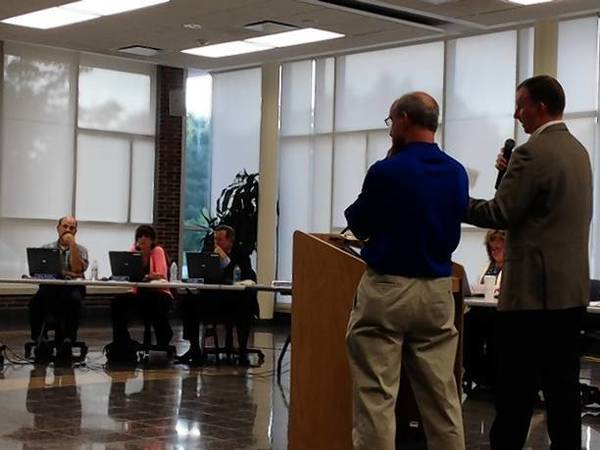 Geneva High Principal Tom Rogers and Athletic Director Jim Kafer spell out changes to the school's conduct code to the District 304 School Board Monday night.