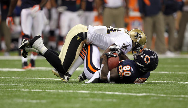 Earl Bennett takes a hard hit from New Orleans' Roman Harper.