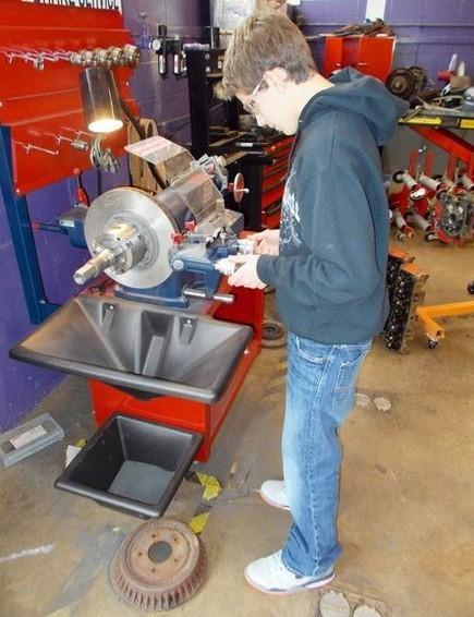 John Guerra is sets up the brake lathe in order to machine a brake rotor.