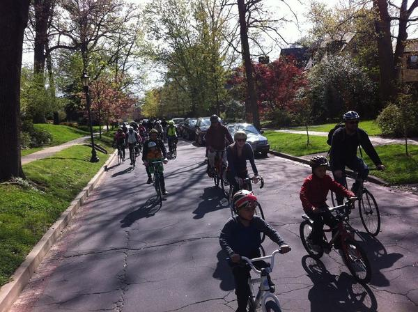 Families bike through Baltimore's Sherwood Gardens in April