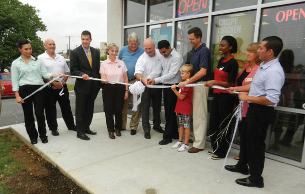 Participating in the Aug. 8 ribbon cutting at Checkers, 1720 Dual Highway in Hagerstown, are, from left, Checkers Manager Ruby Martinez; Ron Bowers, board member for Hagerstown-Washington County Ecomomic Development Commission; Alex Chestnut, representative for U.S. Rep. John Delaney, D-Md.; Ruth Anne Callaham, Washington County Commissioner; Martin Brubaker, Hagerstown City Councilman; Jeffery Buczkowski, R.J. Lock & Security; Malik Mehboob, entrepreneur; Del. Neil C. Parrott, R-Washington, and his son, Neilson Parrott; Alexx, a member of the Checkers crew; Liz Jones, representative for Sen. Christopher B. Shank, R-Washington; and Checkers Manager Mario Tex.