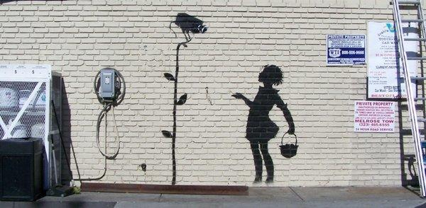 "Banksy's ""Flower Girl"" will go up for auction Dec. 5."