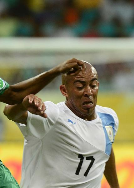 Nigeria's forward Ahmed Musa (L) and Uruguay's midfielder Egidio Arevalo Rios vie during their FIFA Confederations Cup Brazil 2013 Group B match.