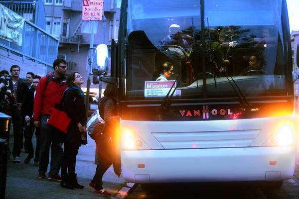 A shuttle to the Google campus loads passengers in San Francisco.