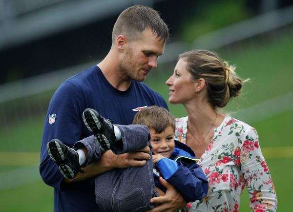 New England quarterback Tom Brady, shown Tuesday with wife Gisele Bundchen and son Benjamin, appeared to be injured during Wednesday's practice.