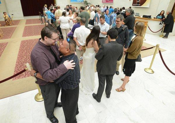Adam Chandler, 33, left, and Ivan Chandler, 38, both of Citrus Heights, wait in line to get married at San Francisco City Hall on June 29 after the U.S. 9th Circuit Court of Appeals lifted the stay on gay marriage in California.