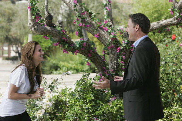 "Gia Allemand is greeted by host Chris Harrison at the ""Bachelor Pad."""