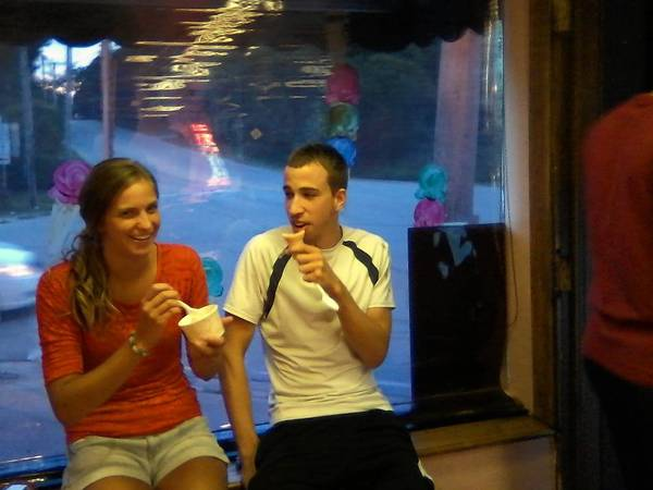 Justine Van Dyk of Palos Heights and Colin Ebels of Crestwood enjoy ice cream inside The Plush Horse in Palos Park. The parlor has been serving up homemade ice cream since the 1930s.