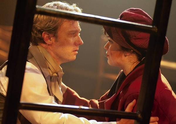 Marius (Jeffrey S. Shankle) pleads with Eponine (MaryKate Brouillet) to leave the barricade for safety and deliver a letter to Cosette.