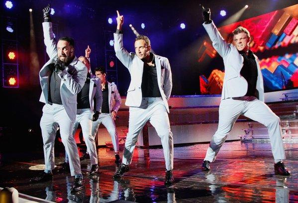 The Backstreet Boy -- from left, A.J. McClean, Brian Littrell, Kevin Richardson, Howie Dorough and Nick Carter -- perform Tuesday in Wantagh, N.Y. They're on tap for Macy's Passport Presents Glamorama.