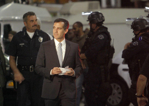 Mayor Eric Garcetti, shown here in July with LAPD Chief Charlie Beck, announced on Wednesday four new appointments to the Police Commission, which oversees the LAPD.
