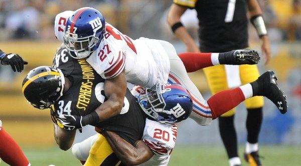 Football's foes say the game is dangerous, but are their fears supported by the facts? Above, the Pittsburgh Steelers and New York Giants face off in an NFL preseason game Saturday.