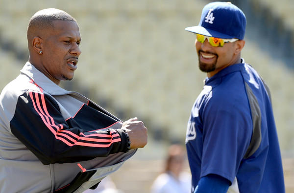 Dodgers center fielder Matt Kemp chats with former major league outfielder Eric Davis before a game earlier this season.