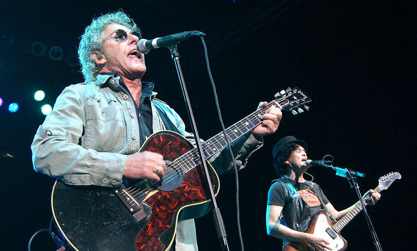 Roger Daltrey, left, and guitarist Frank Simes, open the show with I Can See for Miles at the Pacific Amphitheater show on Saturday.