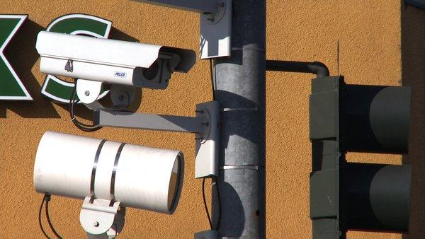 Increasingly, cameras connected to home and public Internet networks are being used by consumers in their homes. Above, a camera at a Los Angeles intersection snaps photos of drivers suspected of running red lights.