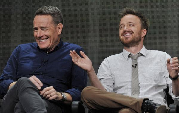 "Bryan Cranston, left, and Aaron Paul, cast members in the television series ""Breaking Bad,"" share a laugh onstage during AMC's Summer 2013 TCA press tour at the Beverly Hilton Hotel."