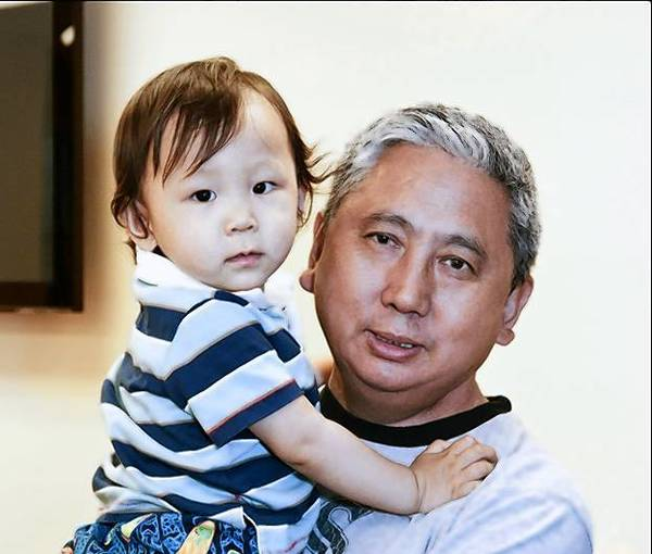 Tsering Dorjee, 44, shown here with his son, was killed while crossing a West Rogers Park street in November. Fernando Perez, who drove off after hitting Dorjee, was sentenced Monday to four years in prison.