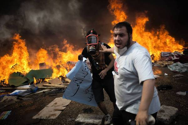 Supporters of ousted Egyptian President Mohamed Morsi flee during a clash with the military near the Rabaa al Adawiya mosque in Cairo, where Islamists had been staging a sit-in demanding his reinstatement. The Health Ministry said 281 people were killed nationwide, including 43 police officers.